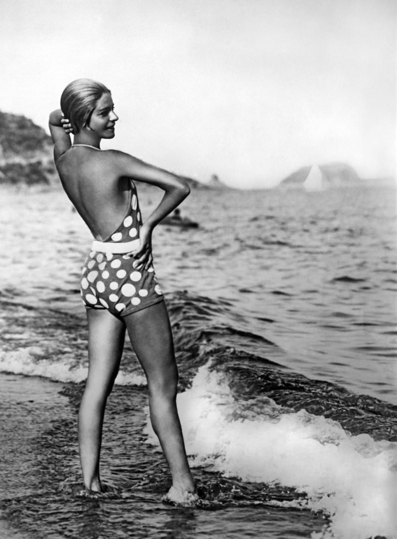 Dancer Alice Nikitina wearing a striking bathing suit at the beach in Alassio, Italy, 1929