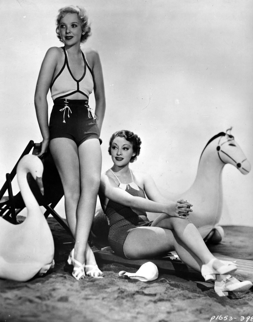 Actresses Ida Lupino and Kathleen Burke model the latest swimwear, 1935