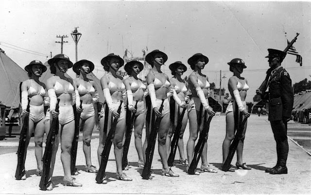 Girls in swimsuits with rifles, 1940s