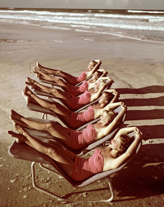 A group of southern belle models sunbathe on the beach at Cypress Gardens theme park, Winterhaven, Florida, 1953