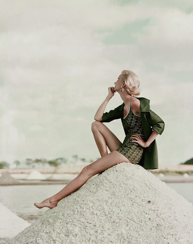 Model is in a tank-top swimsuit in moss green lace over white broadcloth and a beach coat with zipped front, 1954