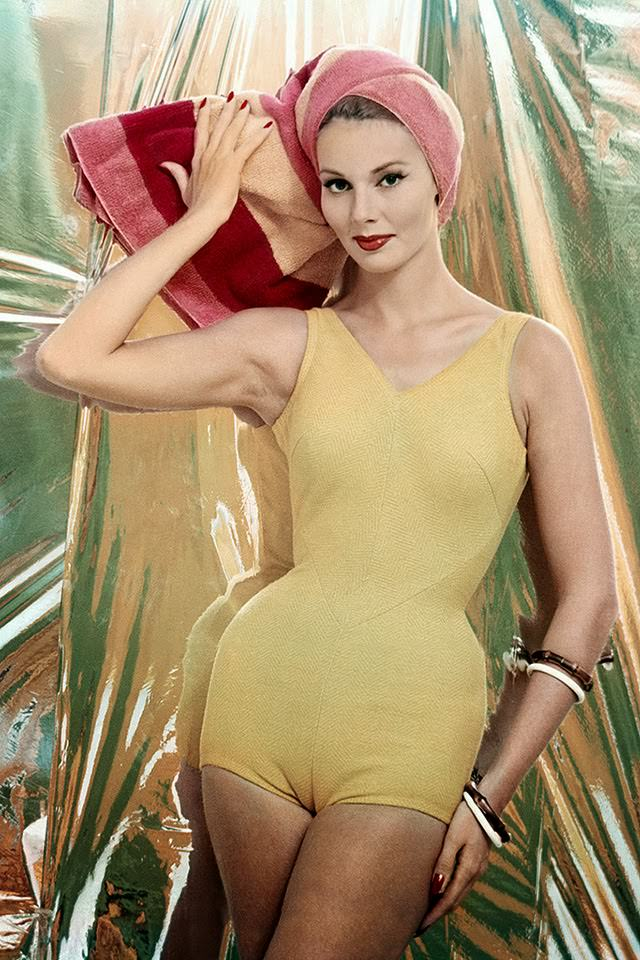 Model in yellow swimsuit of knitted cotton and Orlon, 1959