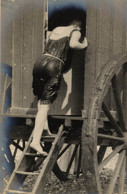 Edwardian woman enters a bathing machine after a swim, 1906