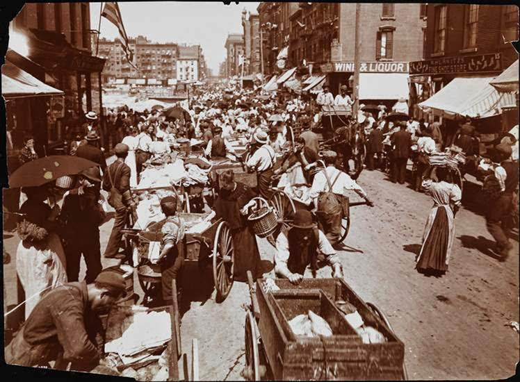Hester Street crowded with women shopping and push-cart peddlers, 1898