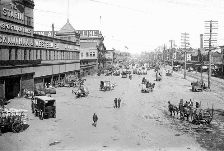 A view of bustling port area on West Street, 1899