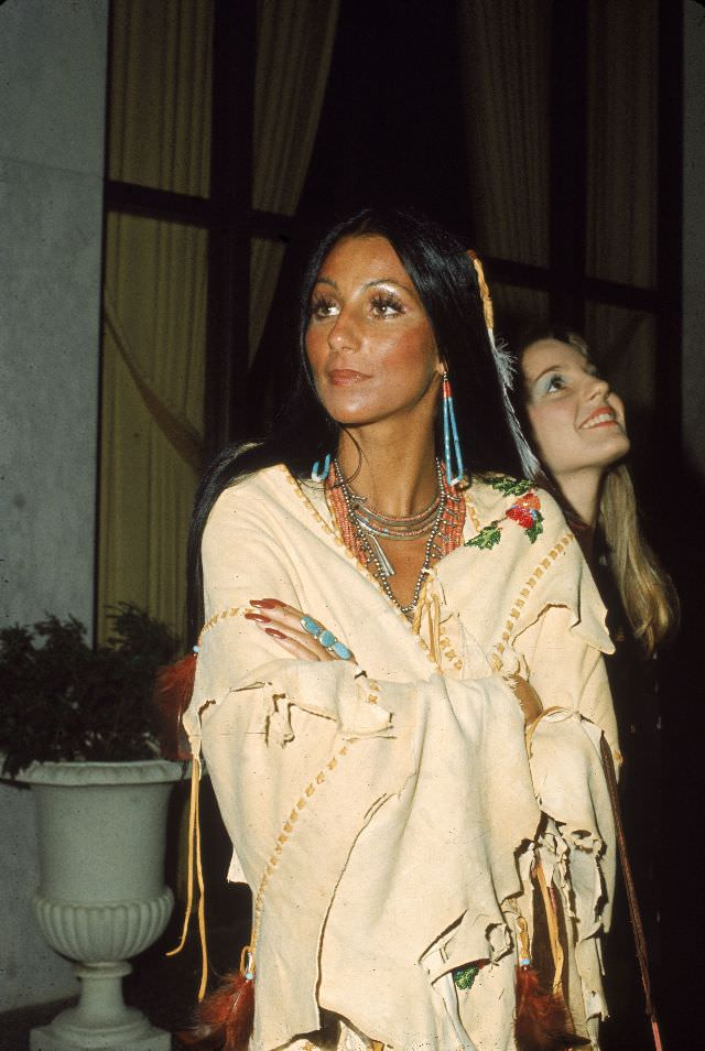 Cher wears beaded jewellery as she stands with arms folded in a Native American Poncho at the premiere of 'Last Tango in Paris.' Photo by Frank Edwards, 1973