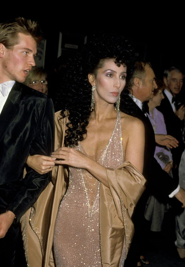 Cher with Val Kilmer at the 56th Annual Academy Awards. Photo by Ron Galella, 1984
