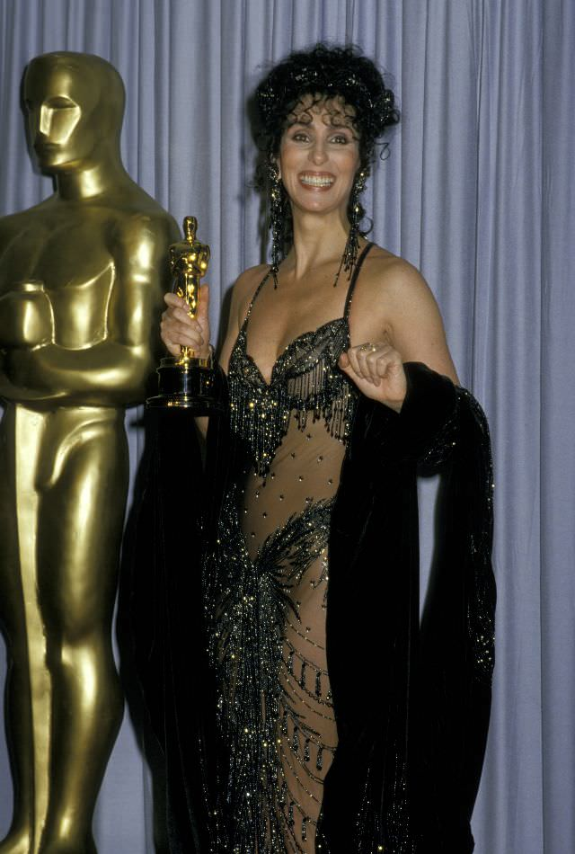 Cher holds her Academy Award for Best Actress at the 60th Annual Academy Awards at the Shrine Civic Auditorium, Los Angeles. Photo by Jim Smeal, 1988