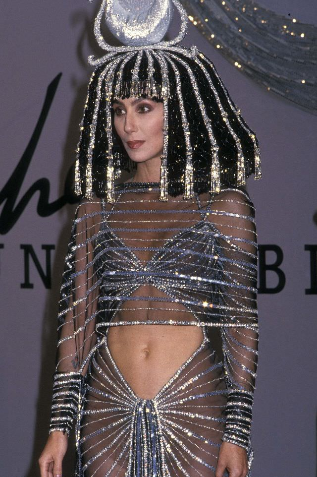 Cher speaks to the press at her Halloween party to promote her new fragrance Uninhibited at Century Paramount Hotel in New York City. Photo by Ron Galella.