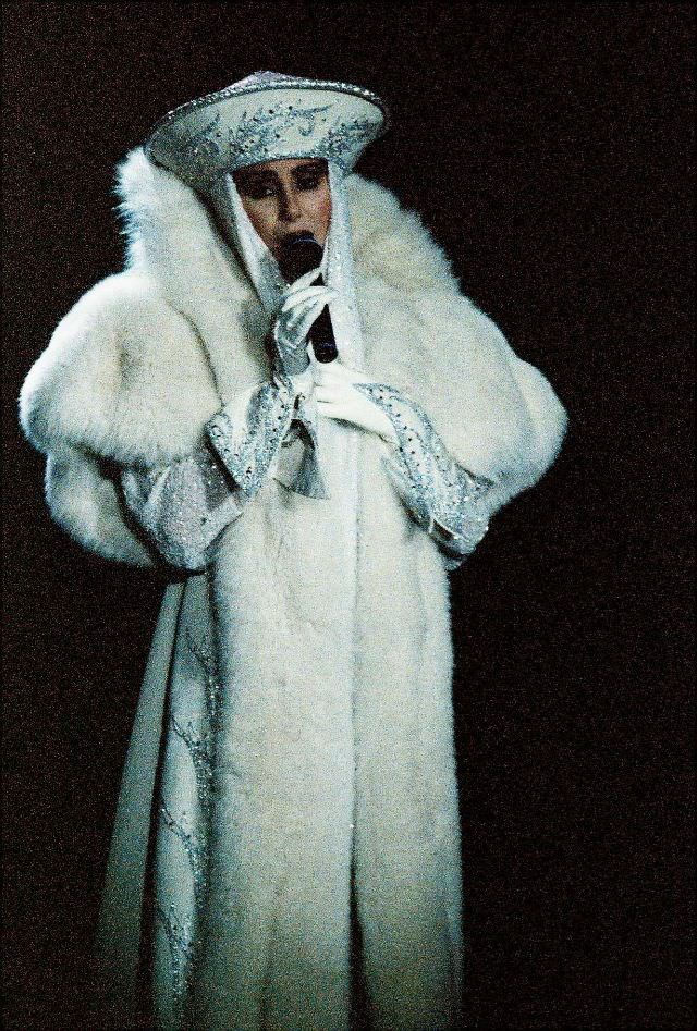 Cher performs on stage at Wembley Arena on her 'Love Hurts' tour in London. Photo by Pete Still, 1992