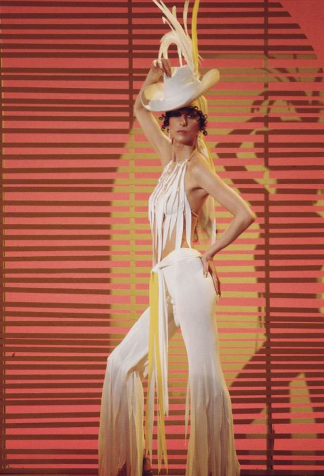 Promotional portrait of Cher, dressed in fringed outfit, for the television variety show 'The Sonny and Cher Comedy Hour, 1972