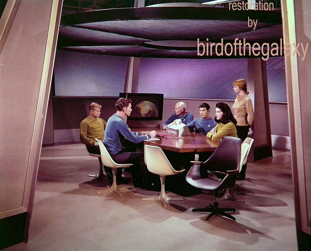 This shot shows a wide view of the set of the briefing room of the Enterprise, during the scene that discusses the fact that Captain Pike has gone missing on the surface of Talos IV.