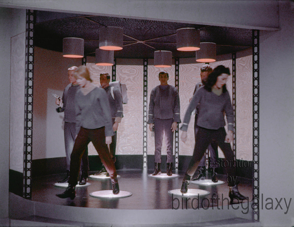 In this shot, Number One and Yeoman Colt both are symmetrically stepping off the transporter platform.