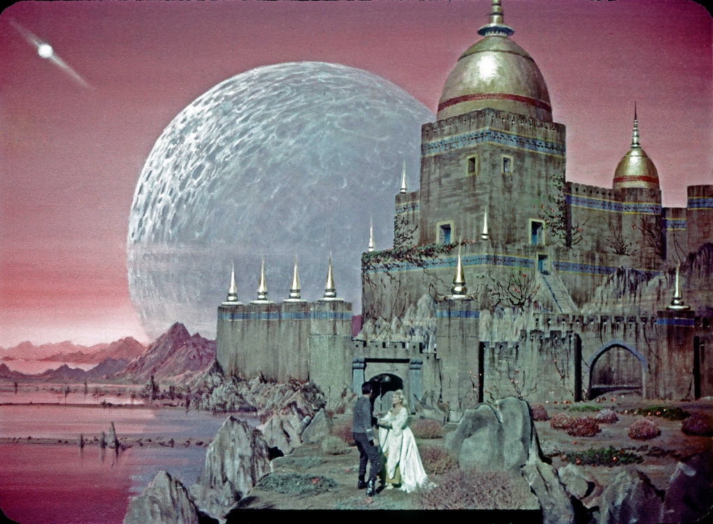Iconic Star Trek TOS image, an illusion recreating a castle and battle with hostile warriors on Rigel VII, now with Vina to protect, as put in the mind of Christopher Pike by Talosians in the first pilot, The Cage.