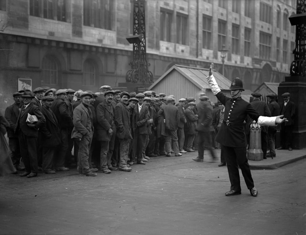 London tram workers queue up for their pay at the tram subway in Kingsway, High Holborn, 1926.