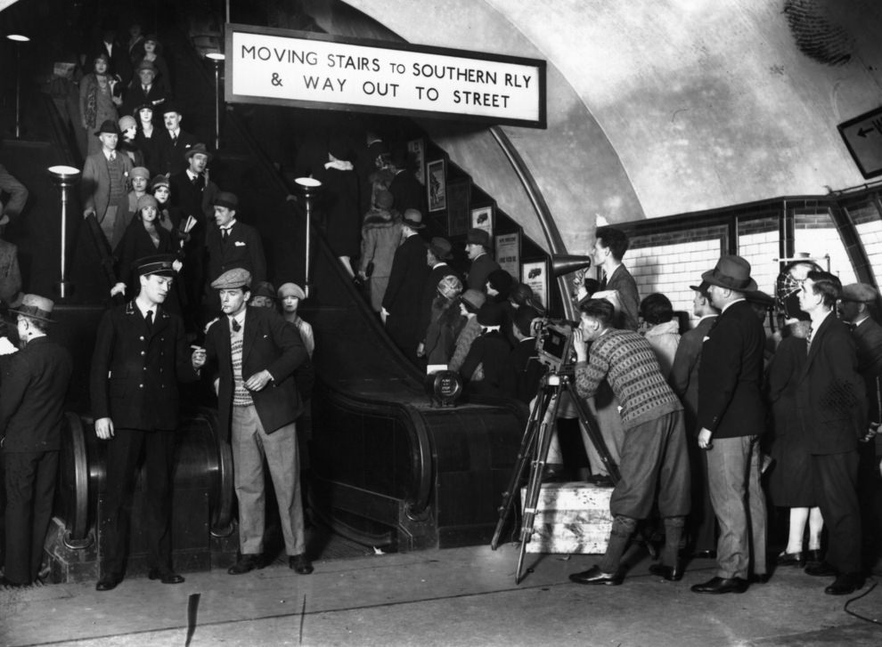 The Hon Anthony Asquith filming commuters for his film of the underground, 1928.
