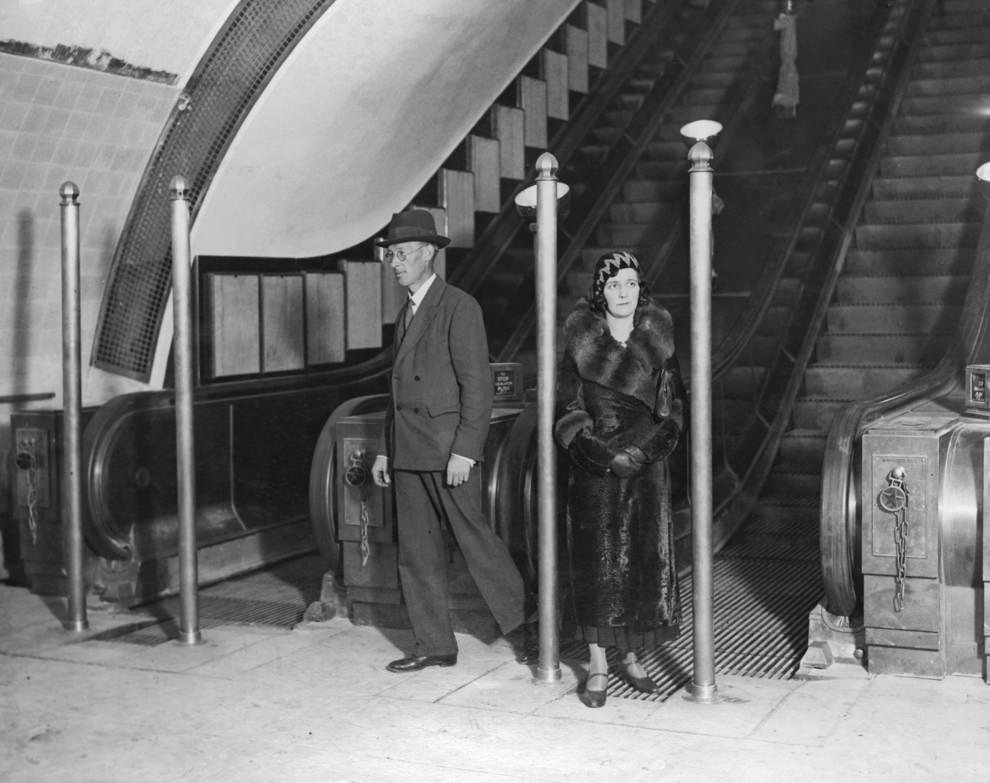 Passengers on an escalator, September 1932. The posts were erected to avoided a crush during rush hours.