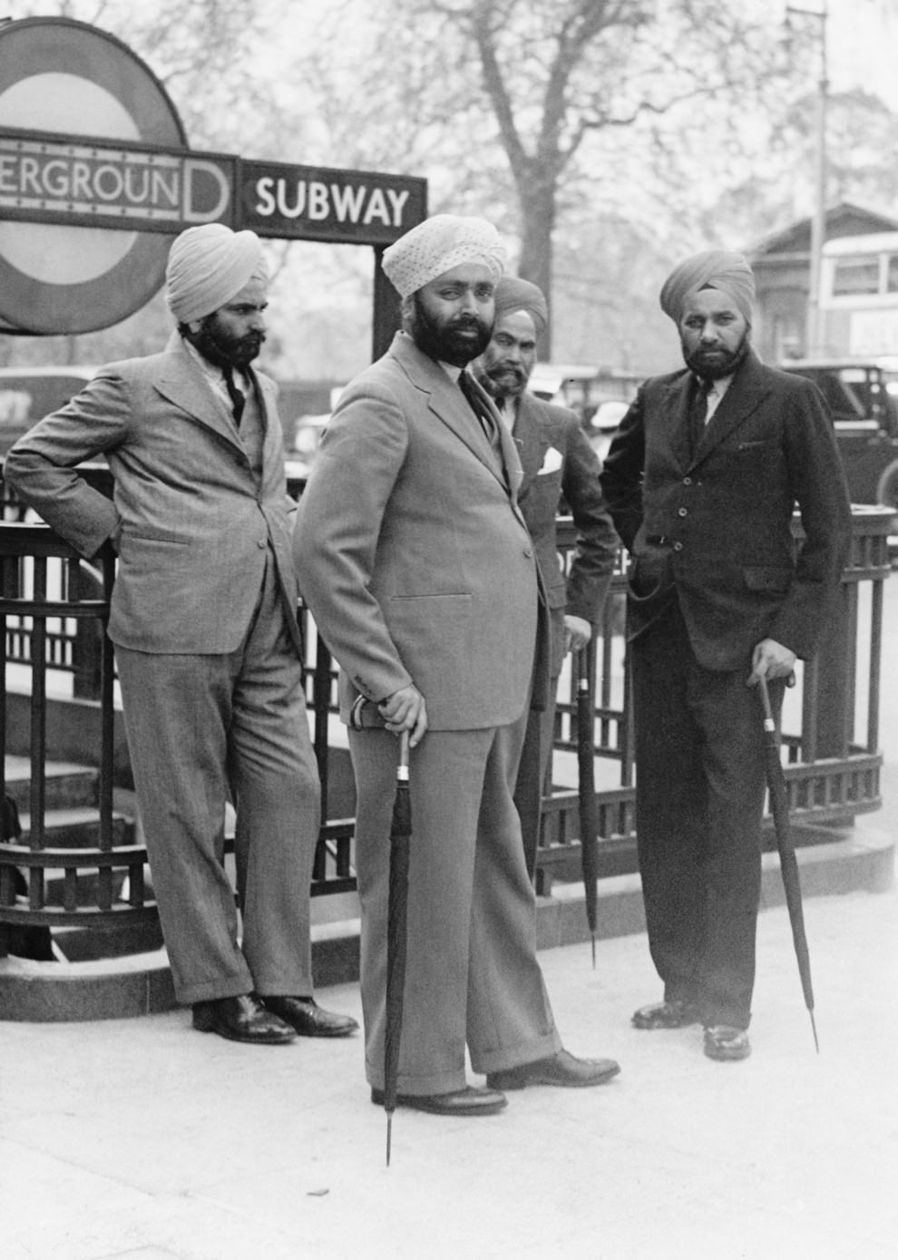 A group of Sikh men outside the entrance to Hyde Park Corner, ca. 1935.