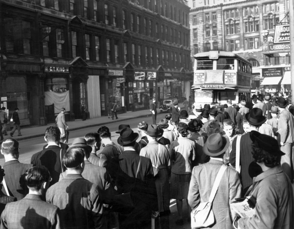 A strike causes huge queues to build up at the bus stops outside Liverpool Street, 1939.