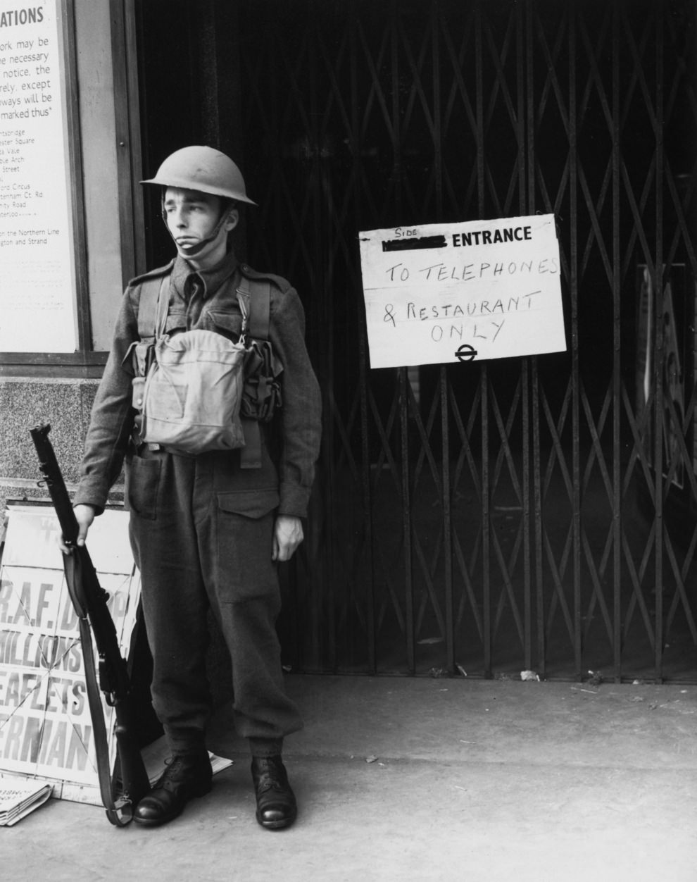 A guard outside a station which has been closed to the public two days after Britain's declaration of war on Germany, 5th September 1939.