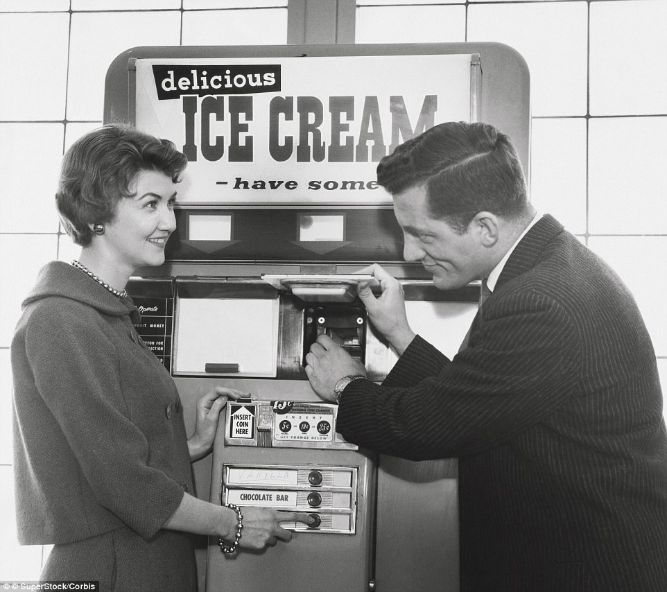 A man uses the cafeteria vending machine called 'Automat', ca. 1940s.