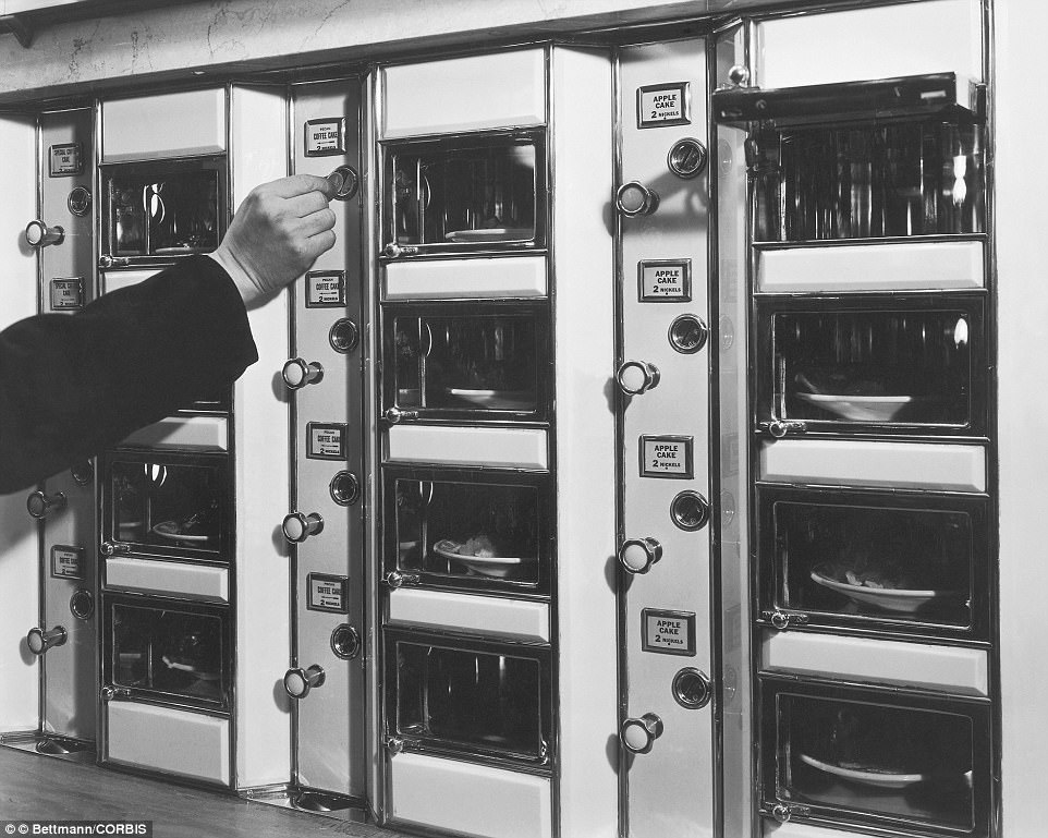 Mid adult couple purchasing ice cream from a vending machine, ca. 1930s.