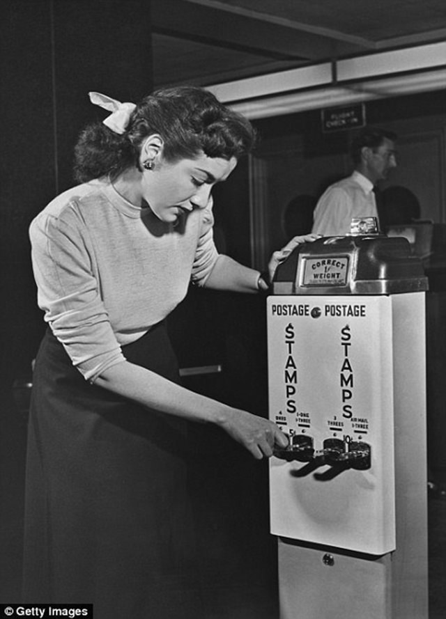 A vending machine at the Post Office allowed customers to buy stamps without having to queue, ca. 1950s.