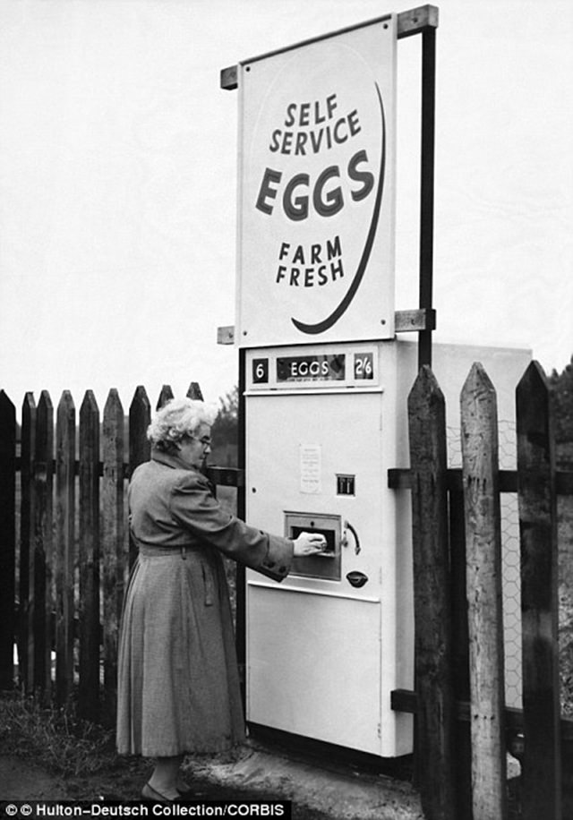 A woman purchases fresh eggs from the machine in Derbyshire, 1963.