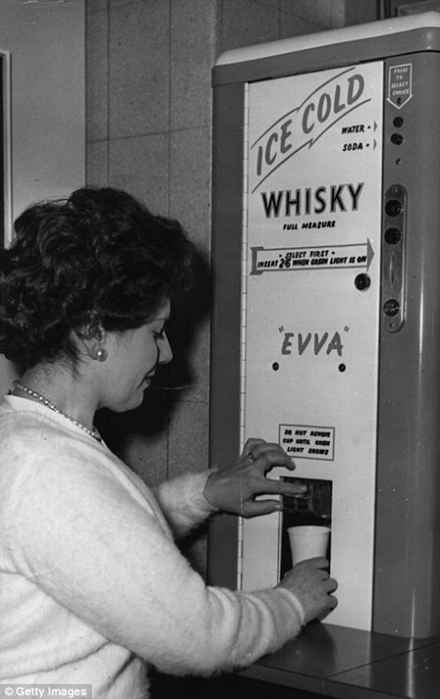 The Sixties saw the rise of self-service booze, a woman buying a whisky, ca. 1960s.