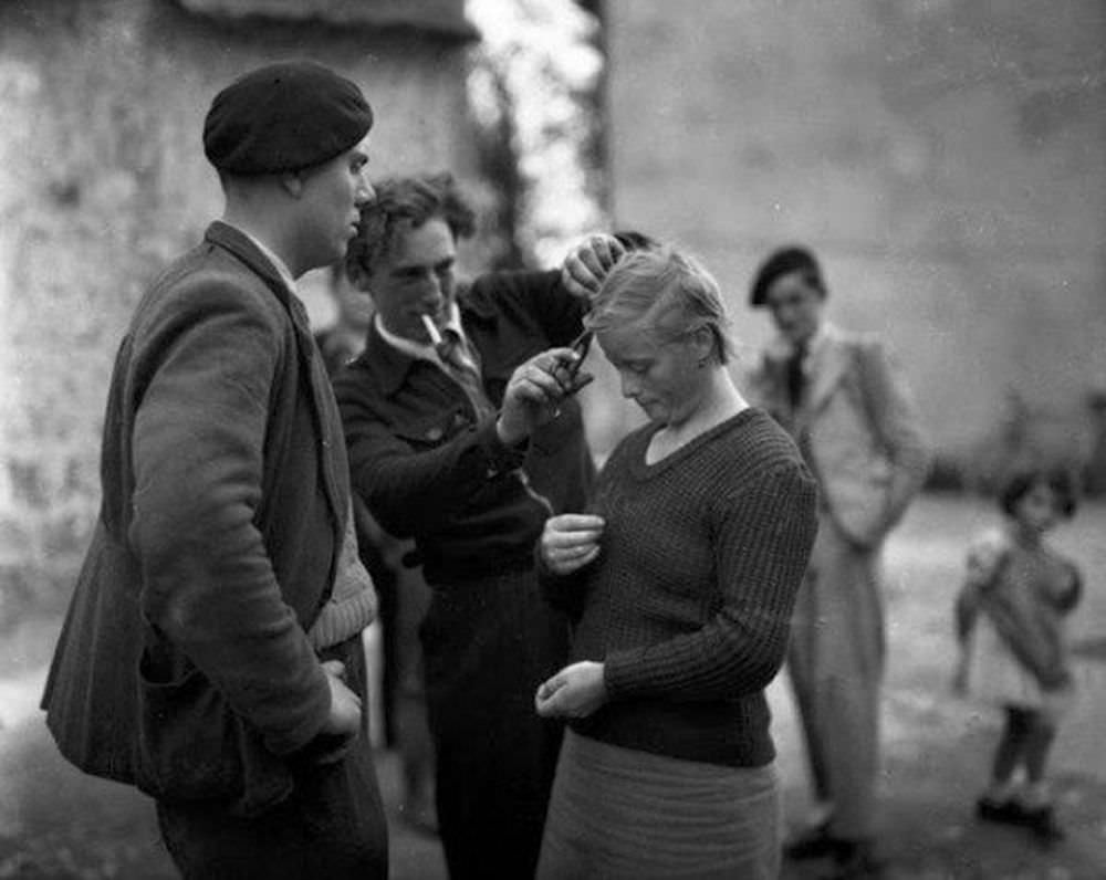 A young woman has her hair cropped by French patriots who accuse her of collaborating with the Germans during the occupation. January 01, 1945.