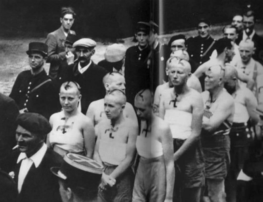 Women with their tops torn off and swastikas scrawled with tar on their faces are paraded through the streets of Paris. Many other women were dragged through the streets naked.