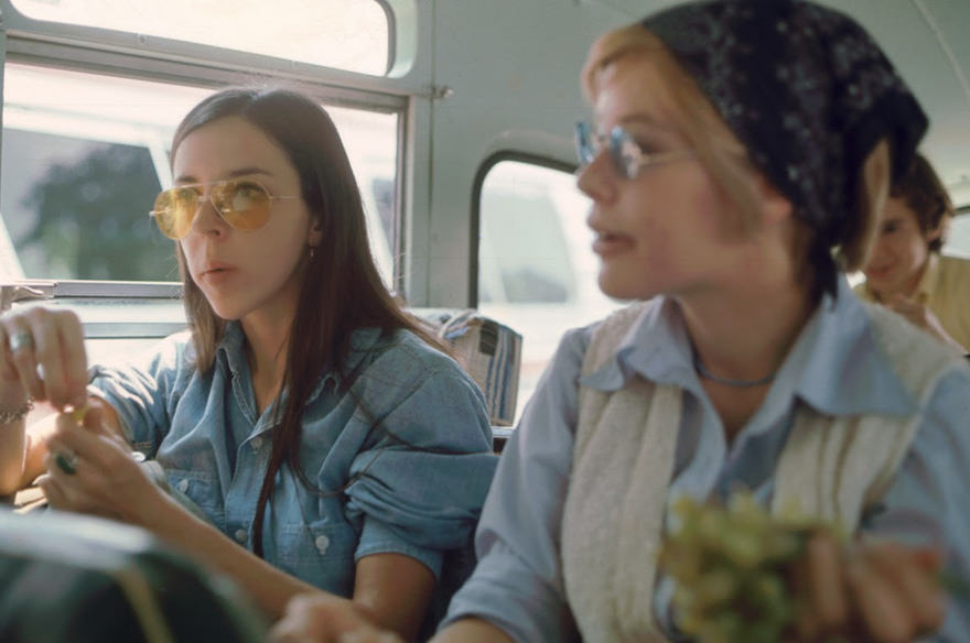 A Pair Of Women Eat Grapes On The Bus To Yasgur's Farm, On Their Way To Attend The Woodstock Music And Arts Fair