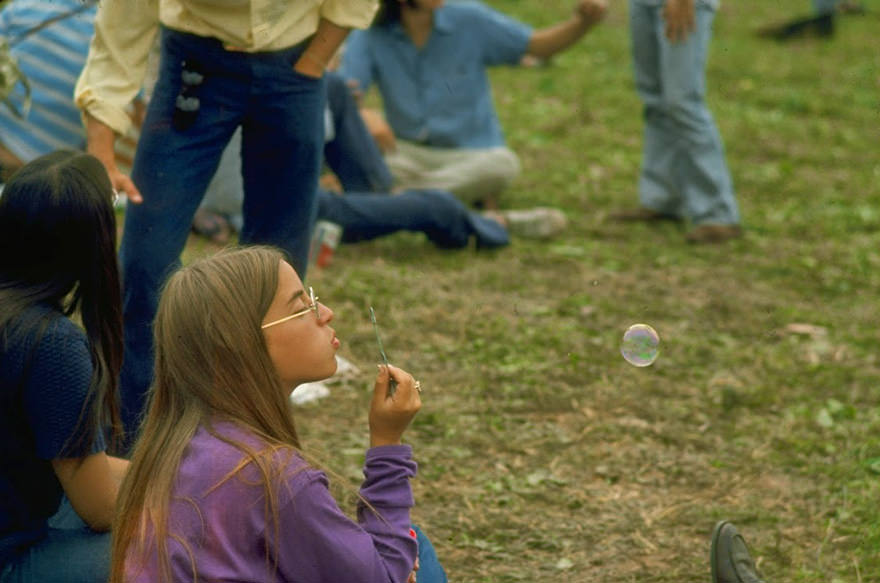 Jackie Barg Siting On The Ground & Blowing Bubbles, During The Woodstock Music & Art Fair