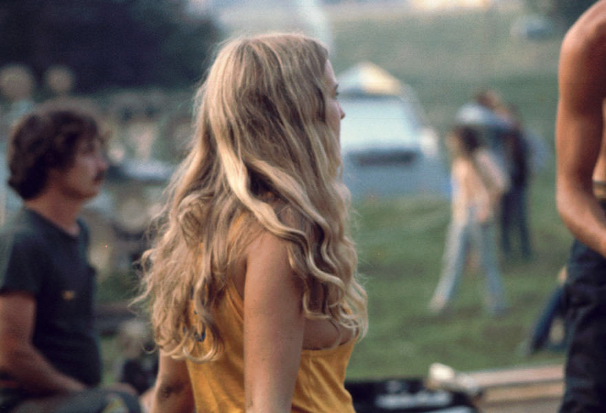 Profile View Of A Young Woman As She Watches A Performance On The 'free Stage' At The Woodstock Music And Arts Fair