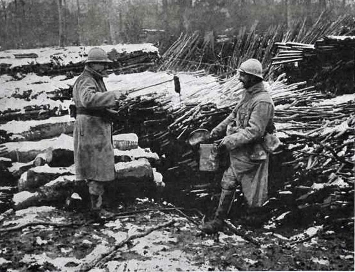 """A French soldier showing his """"catch"""" to his comrade."""