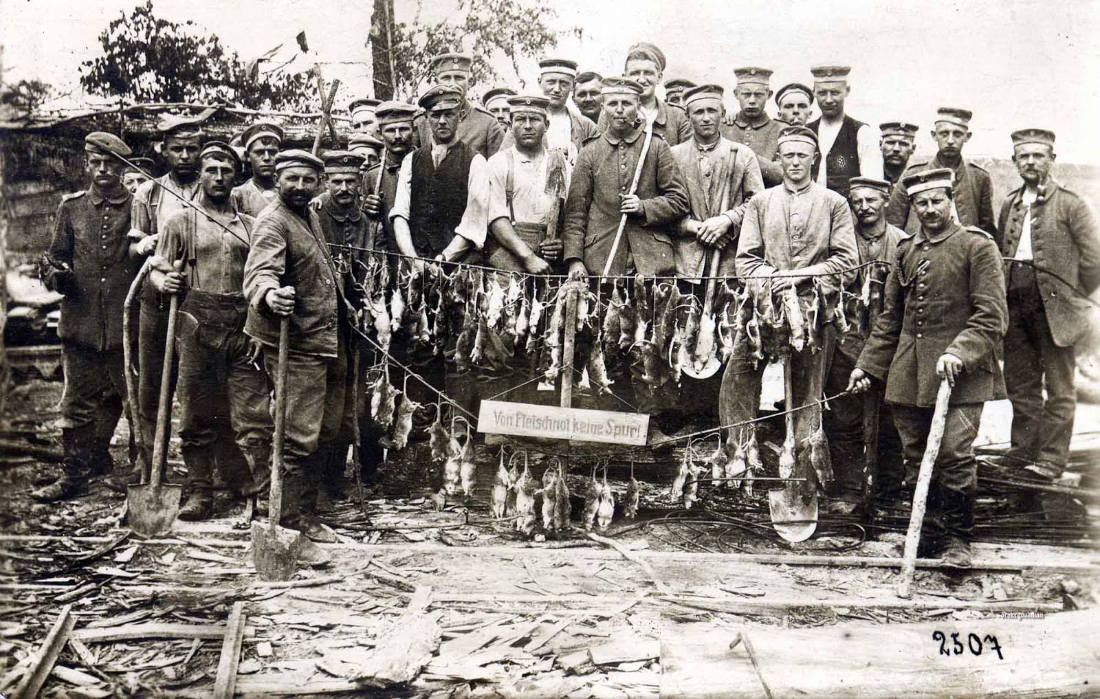 Soldiers posing with the rats, they caught after few hours of hunting. Some of the men are toting shovels and improvised clubs, undoubtedly the weapons of choice in this particular 'Rattenjagd'.