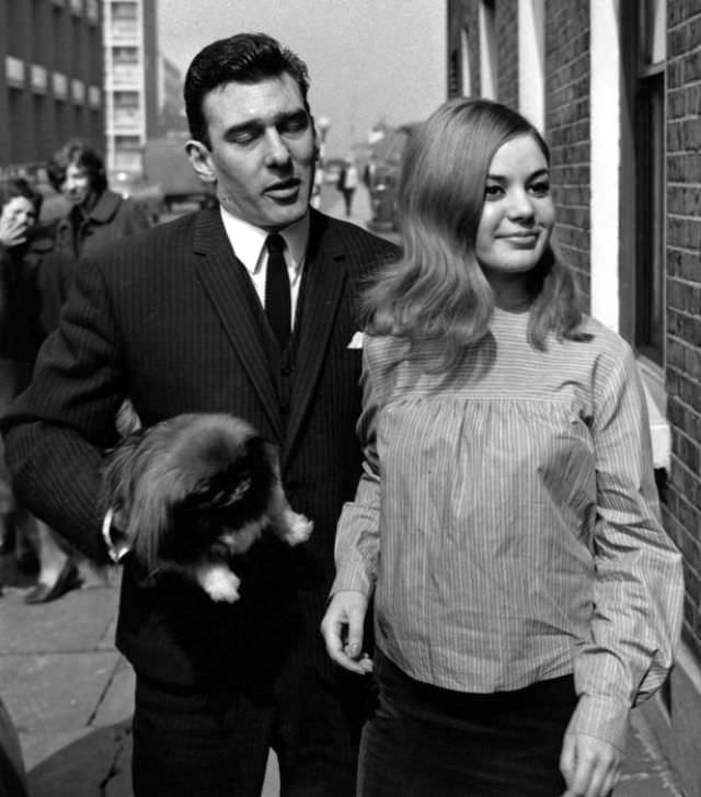 Reggie Kray and Frances Shea outside the Kray home in Valance Road after he and Ronnie are acquitted of all charges of demanding money with menaces, 5th April 1965