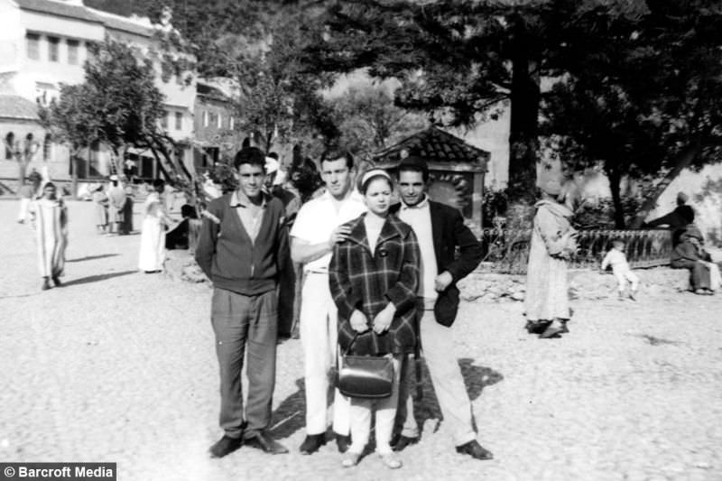 Reg Kray and Francis pose for a group photo with two unknown people, circa 1963, in Tangier, Morocco