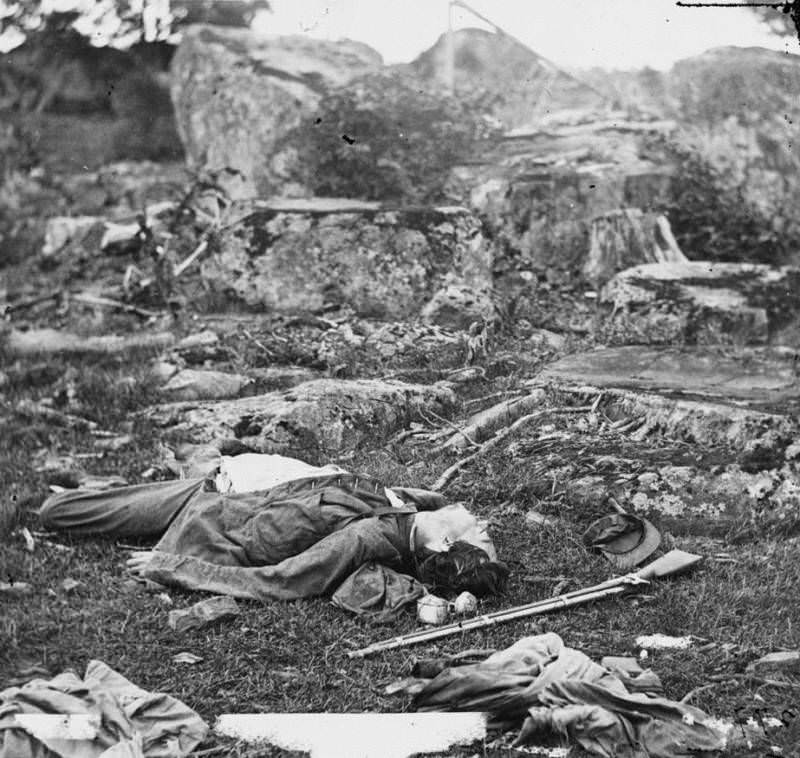 """Confederate bodies lie dead in the area known as the """"devil's den."""""""