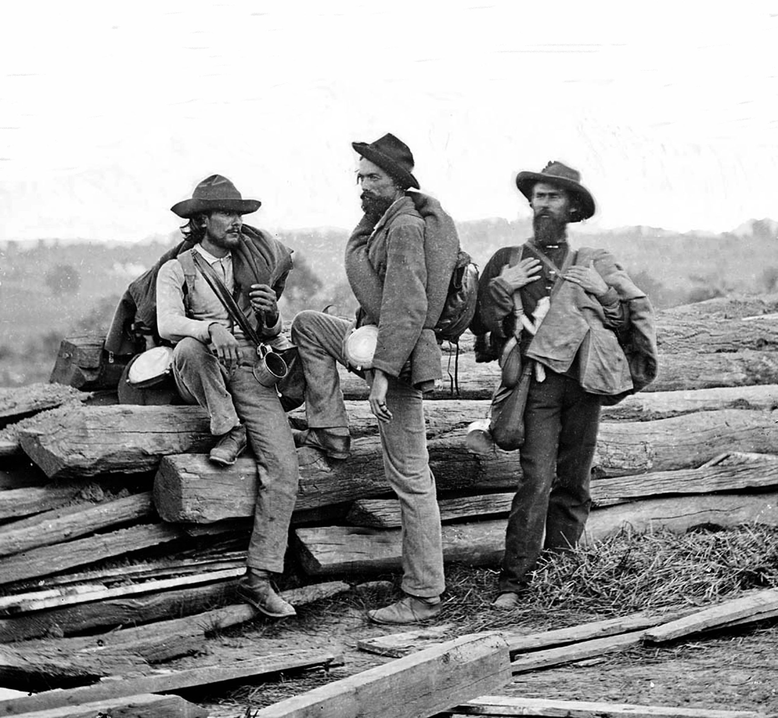 Three Confederate Army prisoners relax after the Battle of Gettysburg, 1863