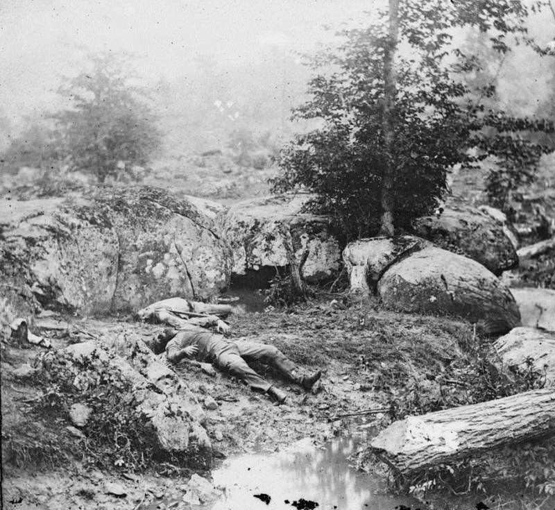 """Dead Confederates lie in the area known as the """"slaughter pen"""" near Little Round Top."""