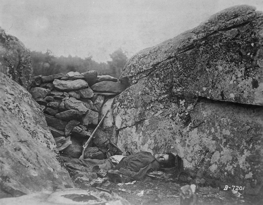 The body of a Confederate sharpshooter is left lying where he was shot.