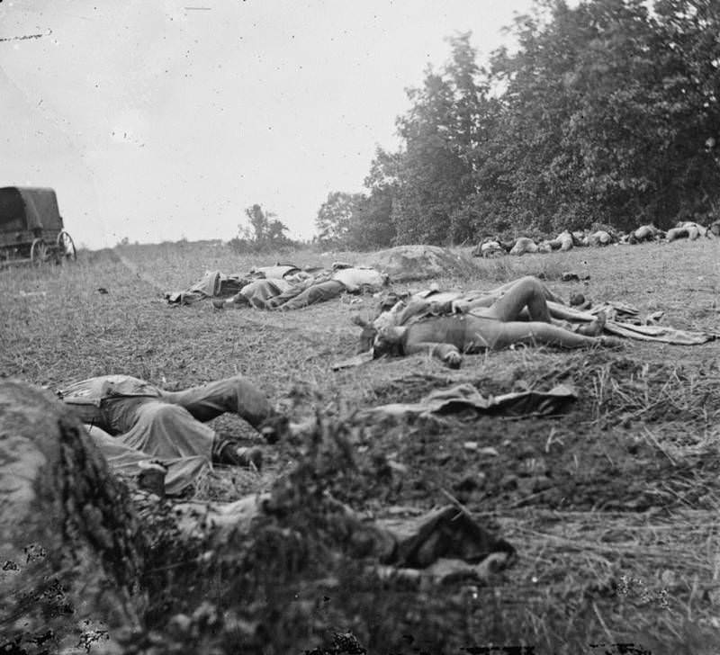 The bodies of Confederate dead are gathered for burial.
