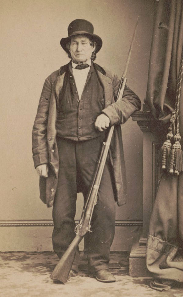 John L. Burns, a civilian who fought alongside the Union at the Battle of Gettysburg, poses for a photo with his musket.