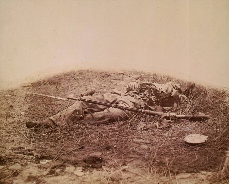 A Union soldier who was torn apart by artillery lies dead on the ground.