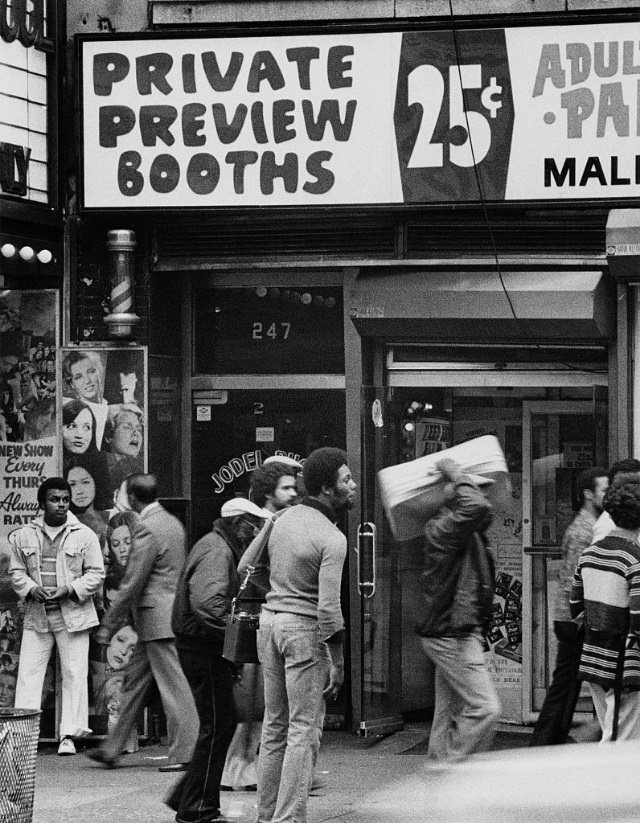 A sign offers 'Private Preview Booths' at a peep show, New York City, circa 1978.