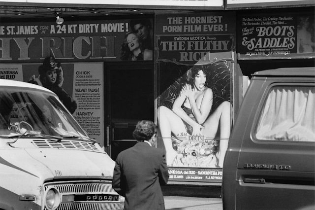 An exterior view of a cinema which is showing the adult film 'The Filthy Rich', New York City, 1982.