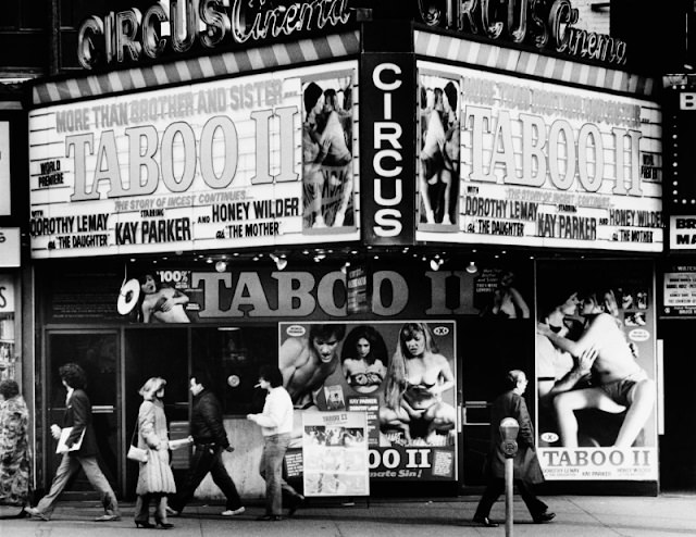 The Circus Cinema in Times Square, showing 'Taboo II', an incest-themed adult film, New York City, 1983.
