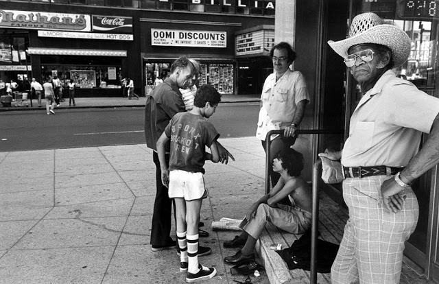 Child prostitutes talk with chicken hawks, men who buy sex with boy prostitutes, in Times Square.