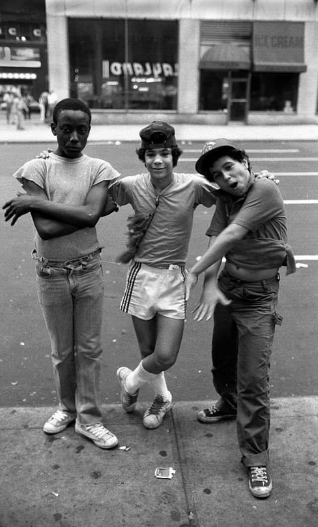 Three boy prostitutes pose for the camera while waiting for customers.